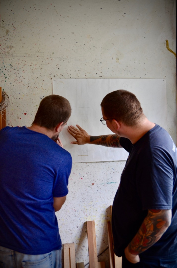 Stefan Huth and Markus Kirchmayr checking plans for a new model